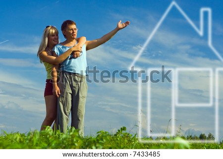 woman and boyfiend  look dream about house