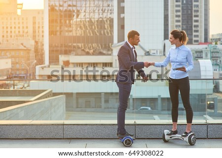 Woman and businessman shaking hands. People on hoverboards, urban background. Tips for successful business partnership.