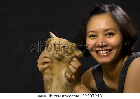 Woman and Cat on Black Background
