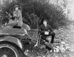 Woman and chauffer after car accident in country