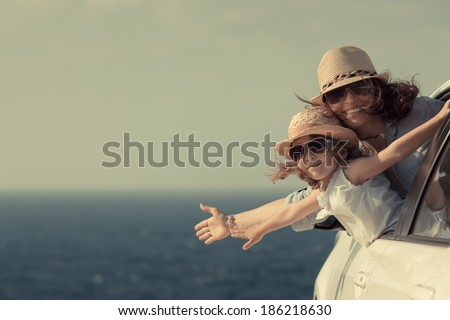 Woman and child at the beach. Summer vacations concept