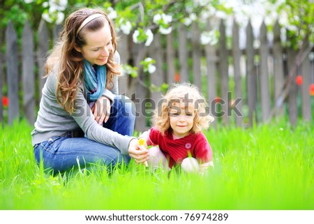 Woman and child in summer garden