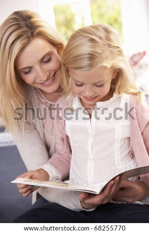 stock photo : Woman and child reading together