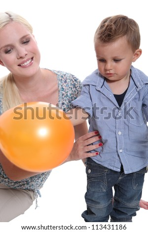 Woman and child with a balloon