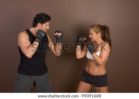 Woman and coach are boxing