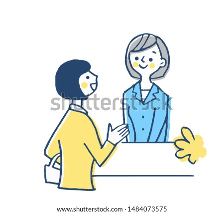 Woman and customer at front desk