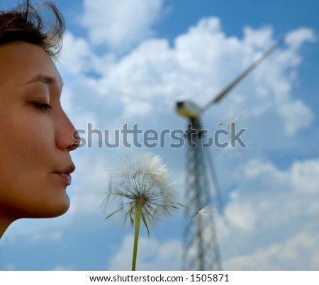 Woman and dandelion flower wind energy concept