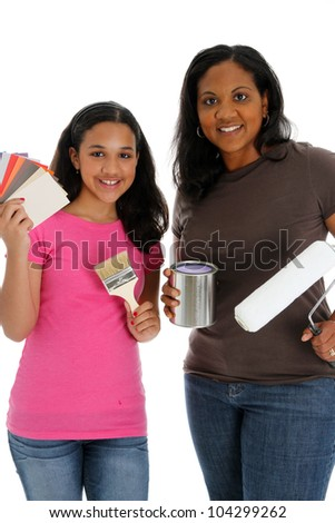Woman and daughter looking at paint chips to use
