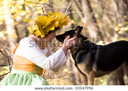 Woman and dog in autumn forest