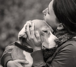 Woman and dog tender hugs