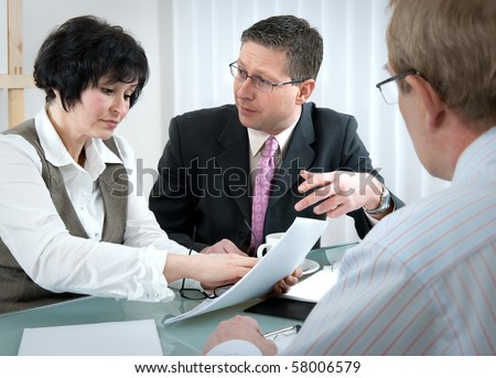 woman and her lawyer in conversation with husband during divorce process