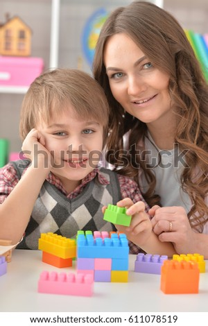 Woman and little boy playing #611078519