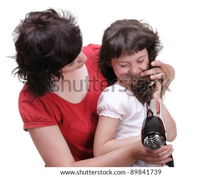 woman and Little girl dries hair, daughter isolated on white