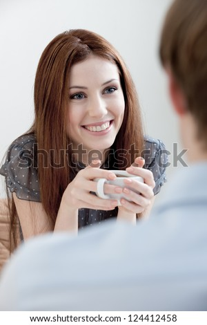 Woman and man are sitting at the cafe