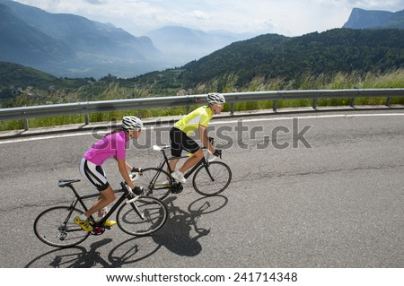 woman and man by uphill with...