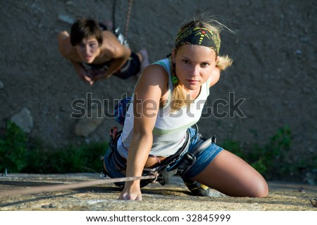 Woman and man engage in extreme sports