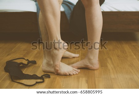 Woman and man making love in bedroom.