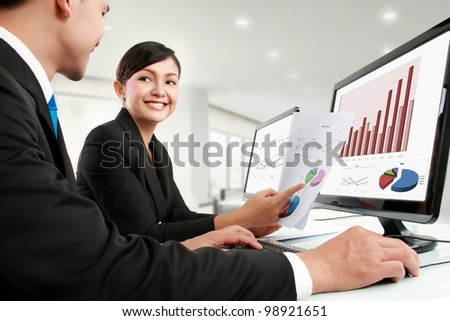 woman and man office worker working in the office - stock photo
