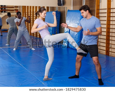 Woman and man practicing self defense techniques in gym Stock photo ©