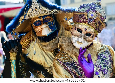 Woman and man with venetian masks