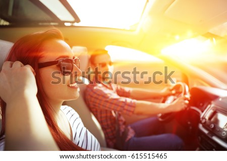 woman and men in car and summer ...