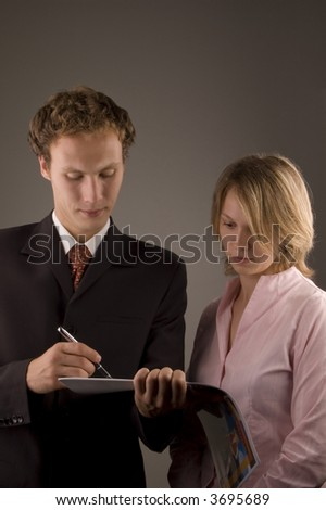 woman and men taking notes