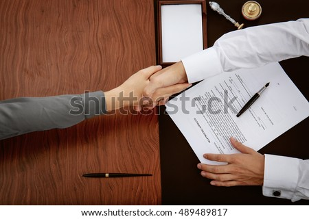 Woman and notary public shaking hands