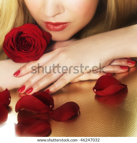 Woman and red rose. Photo was taken with light soft focus filter