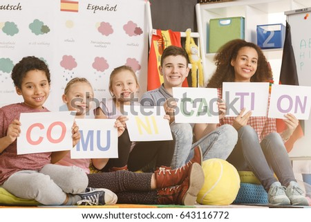Woman and smiling kids holding communication inscription together/Kids holding communication inscription together/Sunny, partly cloudy, cloudy, rainy, snowy, sleeting, icy, tornado, thumder