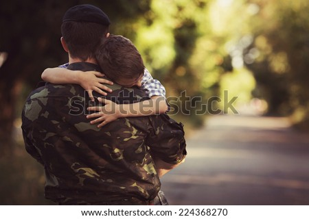 Woman and soldier in a military uniform say goodbye before a separation #224368270