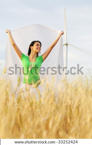 woman and wind, electronic power and alternative energy between turbines and windmill