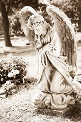 Woman angel kneeling and praying