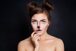 Woman Animal with Artistic Halloween Makeup on Black Background