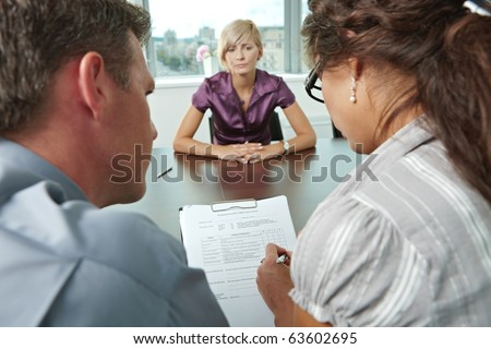 Woman applicant worrying during job interview. Over the shoulder view. Focus placed on sheet in front all results are bad.?