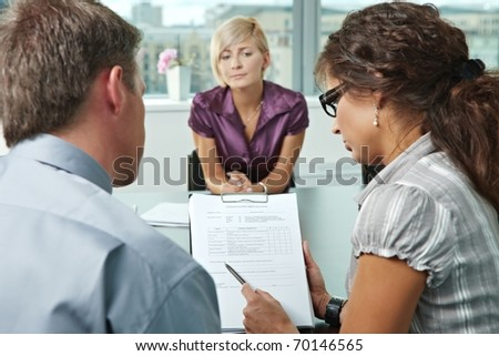 Woman applicant worrying during job interview. Over the shoulder view. Focus placed on sheet in front results are good.?