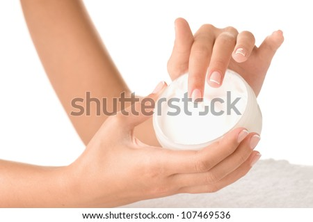 Woman applying cream isolated on white background