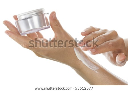 Woman applying cream on her hand