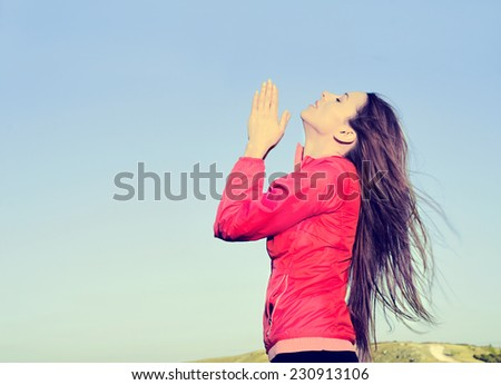 Woman arms raised up to blue sky praying thankful for freedom. Positive human emotions, face expression feeling life perception success, peace of mind concept. Free Happy girl on beach enjoying nature