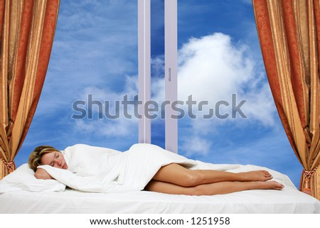 Woman asleep in bed by window