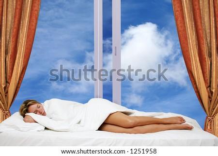 Woman asleep in bed by window