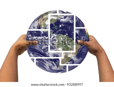 Woman assembling and holding earth photos partitioned and then joined again. Concept of saving earth. Earth photo credit - http://www.nasa.gov