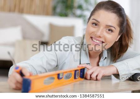 woman assembling new diy furniture at home