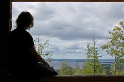 Woman at a viewpoint in Finland