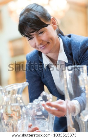 woman at an antique store #1035513373