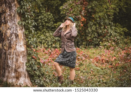 Woman at autumn in fashionable clothes, vogue concept