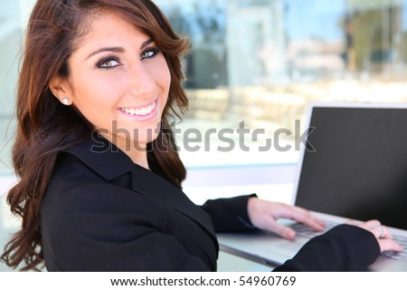 Woman at business office using her laptop computer