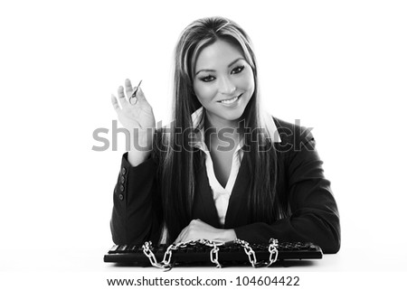 woman at her desk with her keyboard lock up in chains but she has the key so all is good