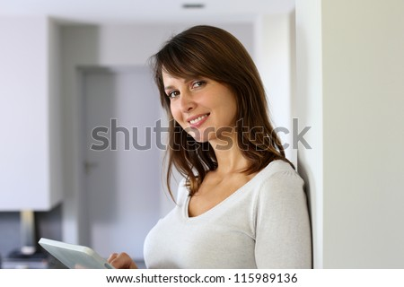 woman at home websurfing on...