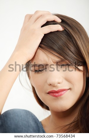Woman at home with terrible headache or big problem