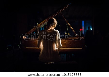 Woman at Piano #1015178335